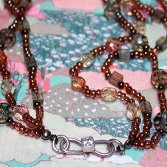 Swarovski crystal and glass beaded multi-strand necklace.