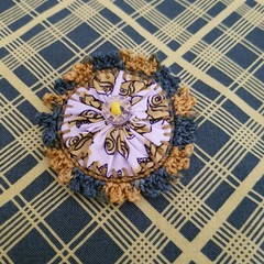 Olive green and yellow vintage Suffolk puff brooch