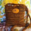 Tunisian crocheted pouch in a burnt caramel yarn