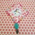 Pretty pink counted cross stitch bird brooch