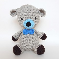 Puppy Dog with a bow tie soft toy crocheted in amigurumi style