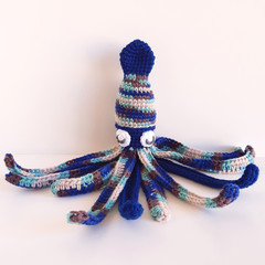 Squid toy in colours blue, green, brown. Marine Ocean theme nursery.