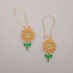 Gold and enamel sunflower smile dangle earrings