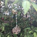 Suncatcher, beaded featuring hanging ornaments