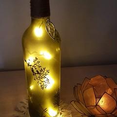Upcycled bottle lights.  birds on branch