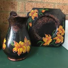 Metal serving platter and ceramic jug.