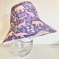 Girls summer hat in purple dino fabric
