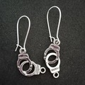 Silver handcuff / freedom charm earrings