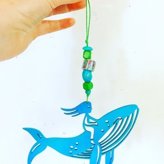 """Whale Rider"" woodcut decoration"