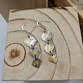 silver and gold diamond shape dangle earrings