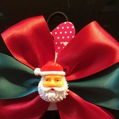 Red and Green bow with embellishment.