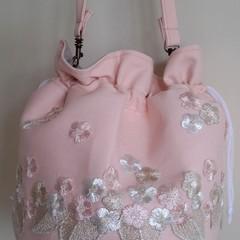 Embroidery round drawstring shoulder bag