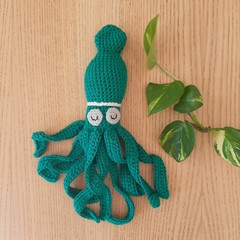 Teal squid with rattle