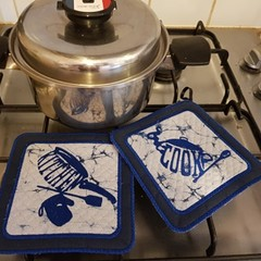 "Set of 2 ""Blue Pot Holders""."
