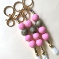 Pink and gold key ring