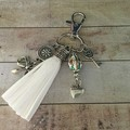 White tassle key charm