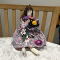 Handmade calico cloth doll.