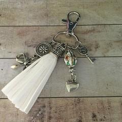 White tassle key charm