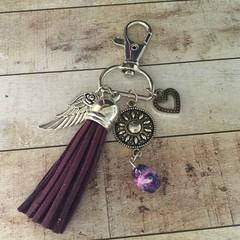 Burgundy tassle key charm