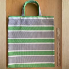 TOTE BAG Green, white & grey striped. Green button closure inside.