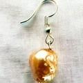 Yellow pearl and tassel earrings.