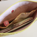 Yellow and pink clutch bag
