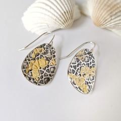 silver and gold teardrop shape earrings