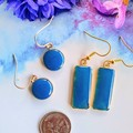 Sapphire Blue round and rectangular drop earrings set in gold.