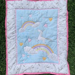 Unicorn and rainbows cot quilt