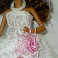 Doll and bridal clothes. 5 piece set. Includes doll.