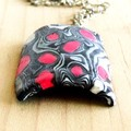 This gorgeous curved piece is of non toxic  polymer clay.