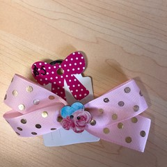 Double looped bow with embellishment.