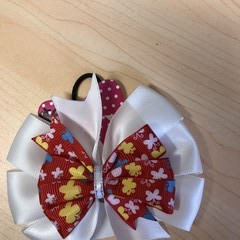 Double layered pinwheel bow. Red and White