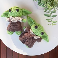 The Child baby Yoda with smile - dark coat -made from recycled cotton