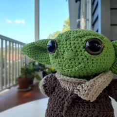 The Child baby Yoda with smile - brown coat -made from recycled cotton