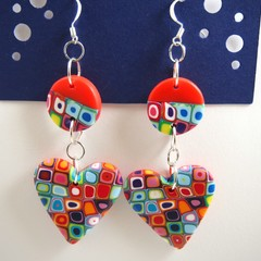 Red base, multi coloured heart dangle earrings