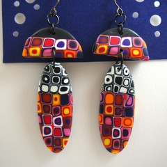 black and white and multi coloured thin oval dangle earrings