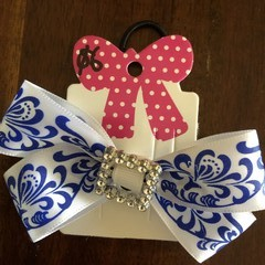 White double looped bow with embellishment.