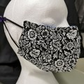Pretty black and white flower pattern facemask. Large for adult female.