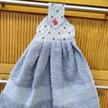 Fabric topped grey hanging hand towel