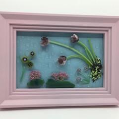 Flowers on rainy glass