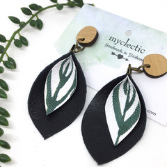 Black Leather earrings with a botanical canvas petal centre