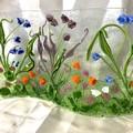 Wavy 3D garden in glass
