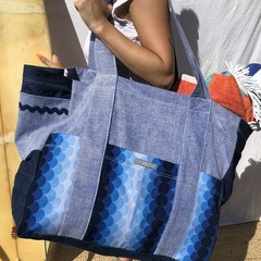 Jumbo beach bag. Made from blue Vintage marble denim and worn in look dark denim