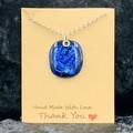 Medium fused glass dichroic pendant.