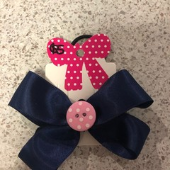 Navy double looped bow with embellishment
