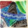 Colourful fused glass platter.