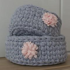 Set of two handmade crochet baskets with flower embellishment