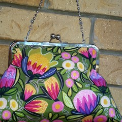 Pink protea clutch with shoulder chain