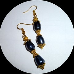 Black Tahitian rice pearls with ornate gold trim